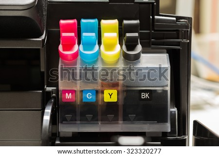 Color tank on ink jet printer - stock photo