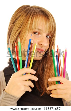 Color the world - 168 - A girl holds in hands of colored pencils - stock photo