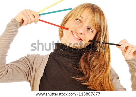 Color the world - 109 - A girl holds in hands of colored pencils - stock photo