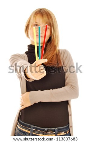 Color the world - 104 - A girl holds in hands of colored pencils - stock photo