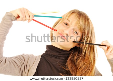 Color the world - 108 - A girl holds in hands of colored pencils - stock photo