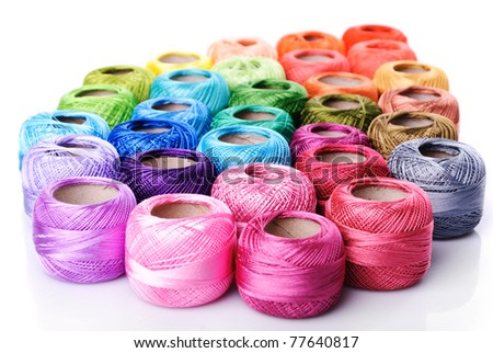 color thread heap isolated on white - stock photo