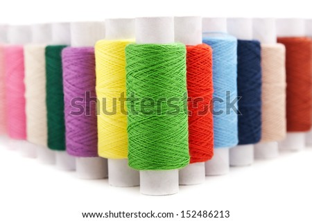color threads isolated on white background - stock photo
