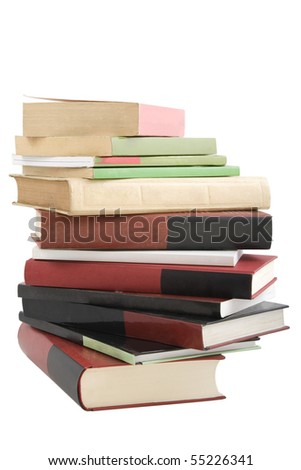 color tower books on white background arranged in stack - stock photo
