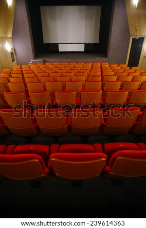 Color vertical shot of some seats in a cinema hall. - stock photo