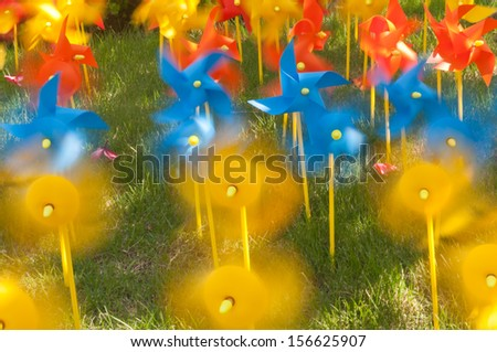color windmills on the lawn - stock photo