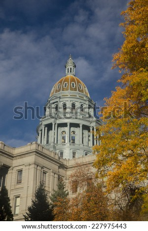 Colorado Capitol With Golden Fall Foliage and Blue Sky - stock photo