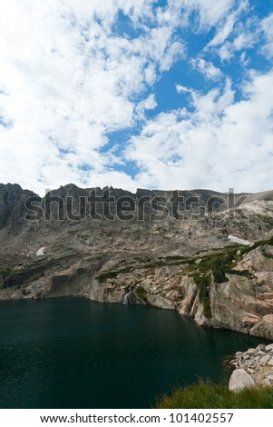 Colorado mountain lake and waterfall landscape - stock photo