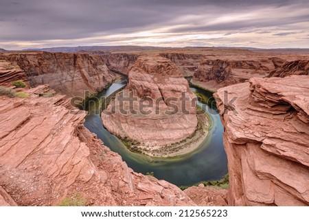 Colorado River Horseshoe Bend at sunset,  Page, AZ.  - stock photo