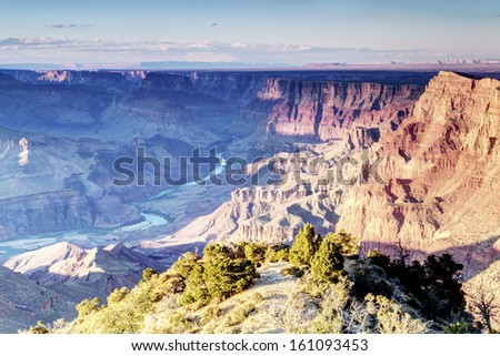 Colorado river in Grand Canyon National Park with rainy cloud from South Rim - stock photo