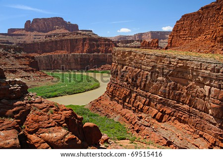 Colorado River overlook from the Shafer Trail in Utah - Dead Horse Point overlook is 2,000 feet above us. - stock photo