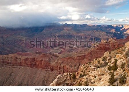 Colorado River winding through Grand Canyon, view from Lipan Point. - stock photo