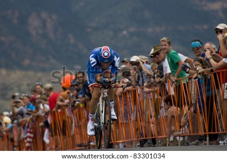COLORADO SPRINGS, CO - AUG 22: Professional cyclist David Zabriskie of Team Garmin-Cervelo is  riding the prologue course of the 2011 USA Pro Cycling Challenge in Colorado Springs, USA on Aug 22, 2011 - stock photo