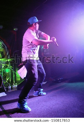 COLORADO SPRINGSMARCH 30:Vocalist Demun Jones of the Alternative Rap band Rehab performs in concert May 30, 2012 at the Black Sheep music hall in Colorado Springs CO. - stock photo