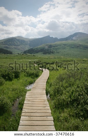 Colorado Summer Mountain Backcountry Scene. Great for themes of nature, summer, mountains, outdoor recreation, travel destinations, background scenic. - stock photo