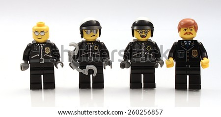 Colorado, USA - March 12, 2015: Studio shot of Lego minifigure police officers. Legos are a popular line of plastic construction toys manufactured by The Lego Group, a company based in Denmark. - stock photo