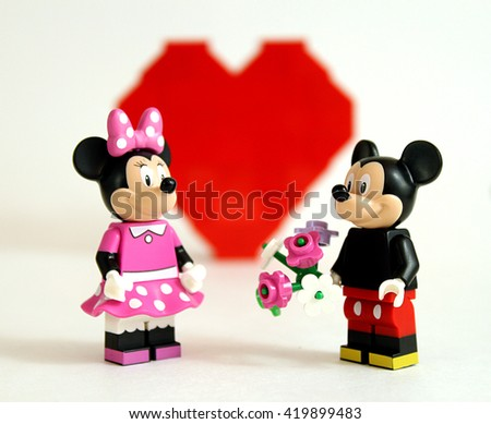 Colorado, USA - May 13, 2016: Studio shot of LEGO minifigure Mickey Mouse and Minnie Mouse in love with flowers and LEGO heart.  - stock photo