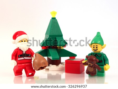 Colorado, USA - October 10, 2015: Studio shot of Lego minifigure Santa and elf depicting a festive Christmas scene. - stock photo