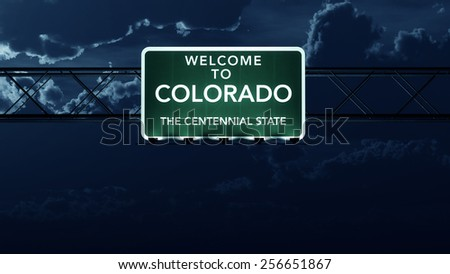Colorado USA State Welcome to Interstate Highway Road Sign at Night - stock photo