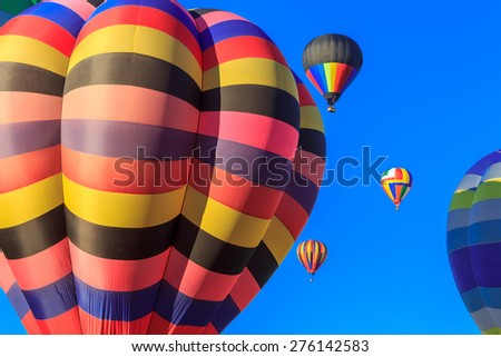 colored air balloons at the blue sky, New Zealand festival - stock photo