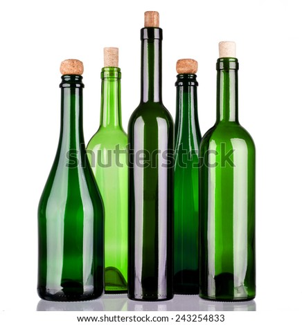 Colored alcohol bottles on a reflective surface with white background - stock photo