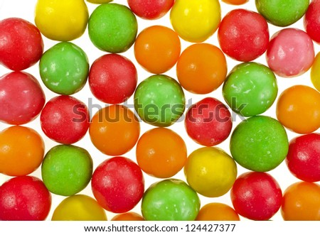 Colored background of assorted candies balls - stock photo