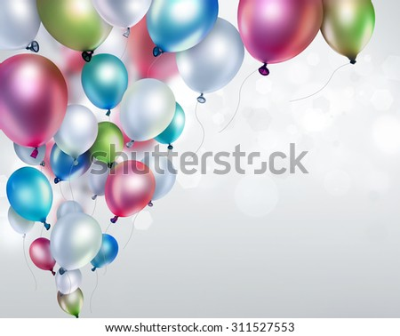 colored balloons on light blurred background - stock photo