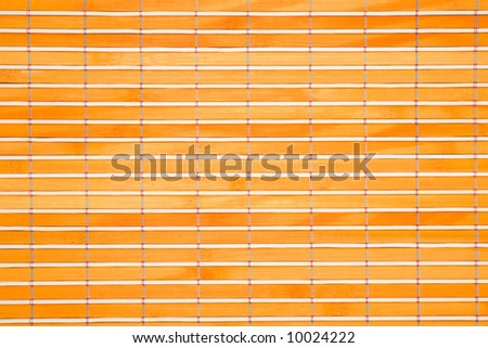 Colored bamboo table-cloth close-up - stock photo