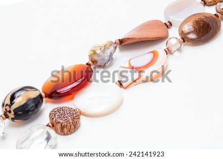 colored beads on a white background - stock photo