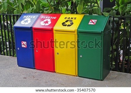 Colored Bins For Collecting Recycled Wastes - stock photo