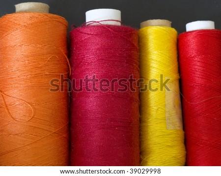 colored bobbins in the line - stock photo