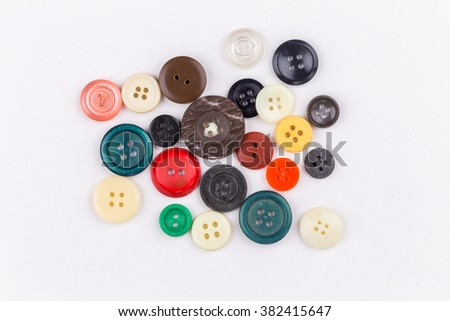 Colored buttons on white background - stock photo