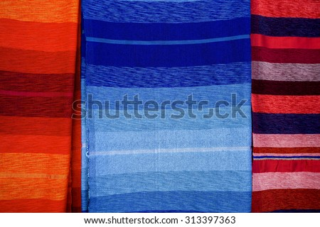 Colored carpets and fabrics in the souk of Marrakesh, Berber culture, Morocco - stock photo