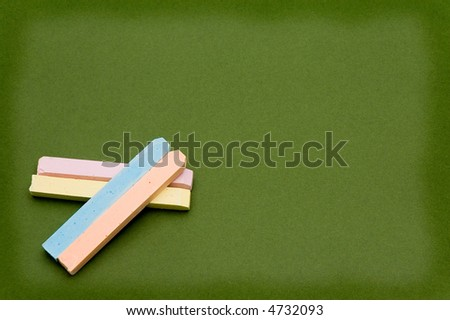 colored chalk and board - stock photo