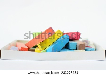 colored chalk for drawing on a white background - stock photo