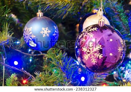 Colored christmas balls on tree - stock photo