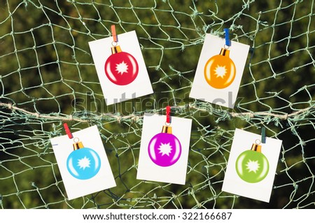 colored christmas balls photographs on the beach at sunset - stock photo