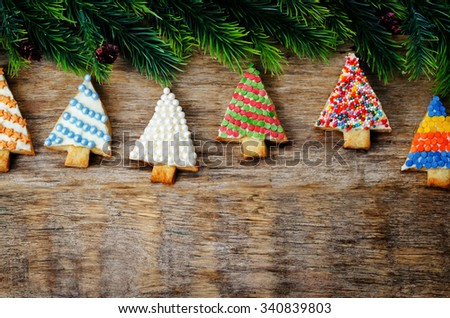 colored Christmas tree cookies on a dark wood background. toning. selective Focus - stock photo