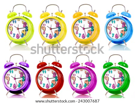 Colored clocks isolated on white background - stock photo