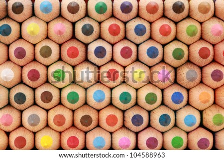 Colored crayons in a stack showing their tops. - stock photo