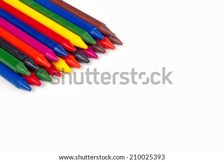 colored crayons on a white background - stock photo