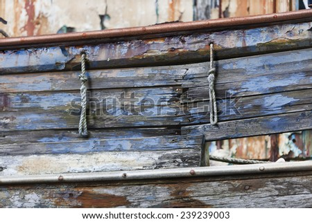 Colored detail of an old and abandoned ship.  - stock photo