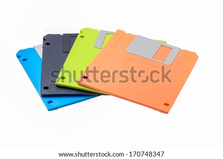 Colored diskettes isolated on white background. - stock photo