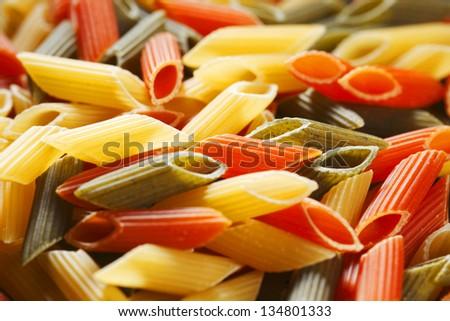 Colored dry italian pasta background - stock photo