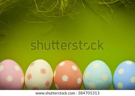 Colored Easter eggs and green background - stock photo