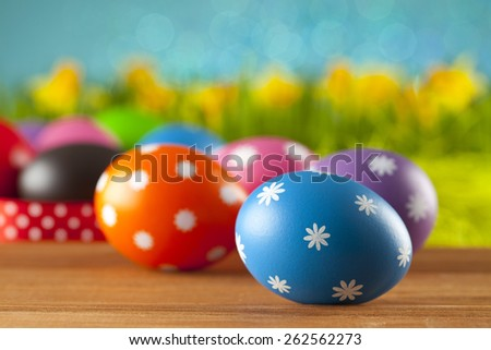 Colored Easter eggs on blue background - stock photo