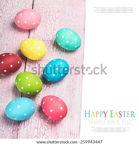 colored Easter eggs on wooden background. The text serves as an example and can be easily removed - stock photo