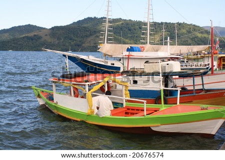 colored fishingboat in harbor - stock photo