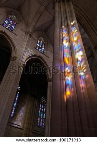 Colored flecks of sunlight on the columns of the Batalha Santa Maria da Vitoria Dominican abbey, Portugal - stock photo