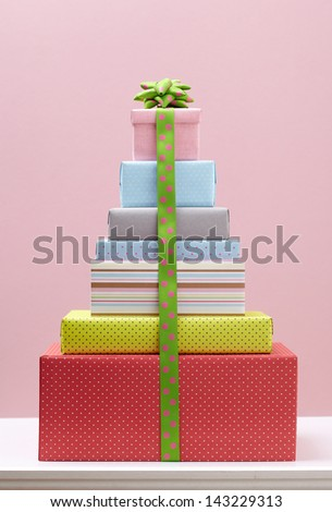 colored gift box with decorative bows on white table. Group of presents. Gift boxs with origami bows. - stock photo
